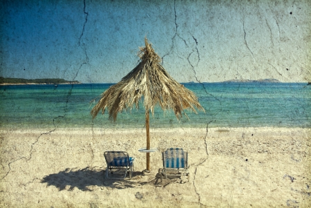 Vintage photo of sunbeds and umbrella on the beach photo