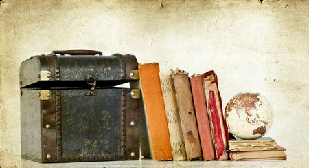 latitude: Pile of old books on vintage background with Earth globe and box