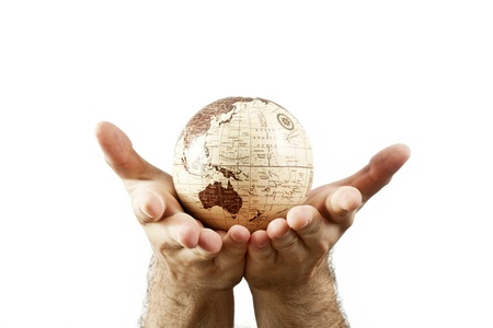 Hands holding Earth Globe isolated photo