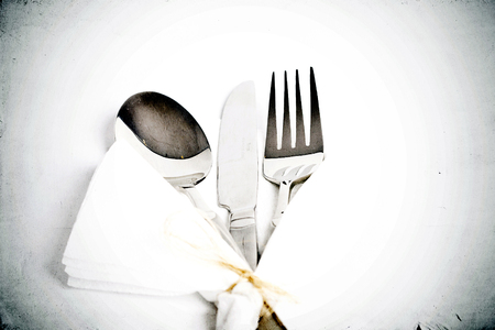 Vintage silverware on grunge  photo