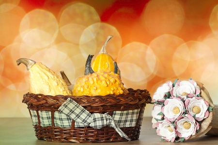 Autumn concept with seasonal pumpkins and flowers  photo