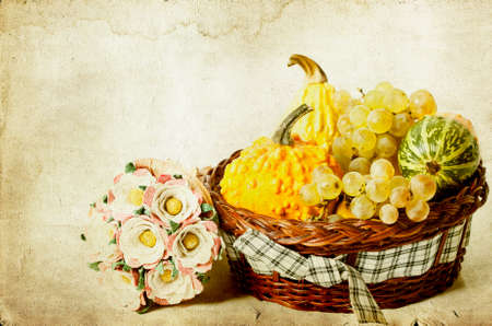 Autumn concept - Pumpkin and grapes on vintage autumn   photo