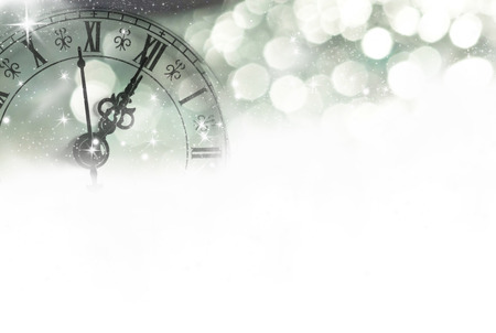 Close up on a vintage clock with sparkling background Stock Photo - 22852934