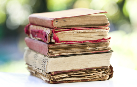 Close up on old books on colorful bokeh background