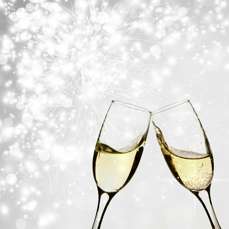 celebration champagne: Glasses with champagne against holiday lights Stock Photo