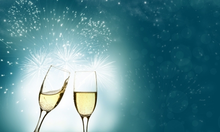 uncork: Glasses with champagne against holiday lights  Stock Photo