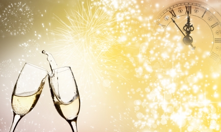 Glasses with champagne against fireworks close to midnight  Stock Photo