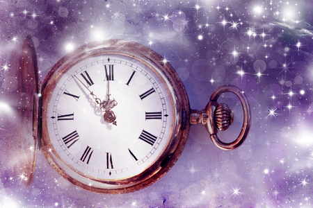 Vintage golden clock on abstract background photo