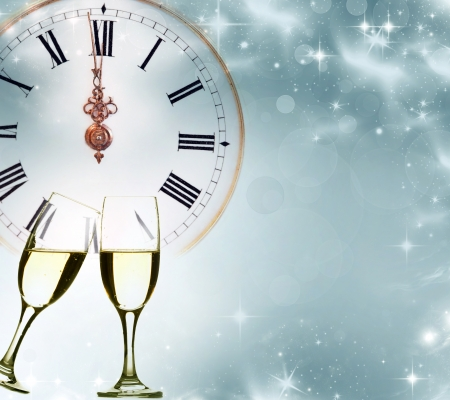 against the clock: Glasses with champagne against clock and holiday background