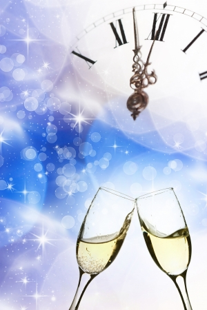 Glasses with champagne against holiday light and snowflakes Imagens