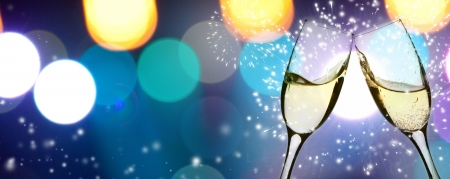 Two glasses of champagne with colorful lights in the background