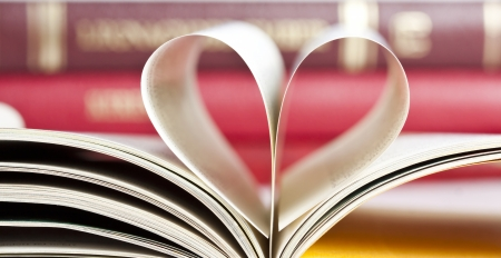 Close up on heart shaped book pages  photo