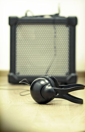 Headphones and guitar amplifier photo