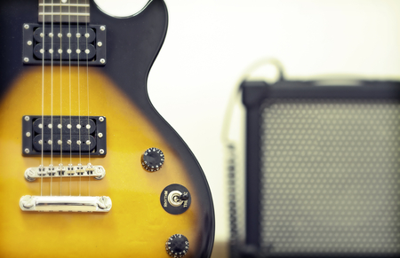 Guitar with amplifier in the background photo