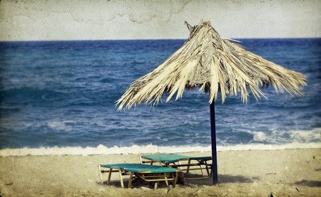 Vintage photo of chairs and umbrellas on the beach  photo
