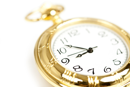 Close up on old styled gold pocket watch  photo