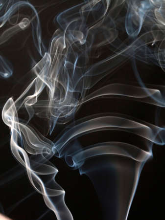 Abstract light smoke isolated on black  photo