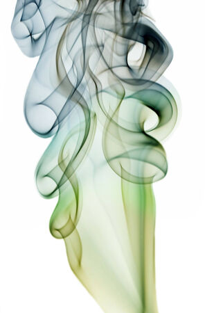 Abstract different colored smoke isolated on white photo