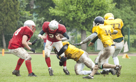 American football game in rain