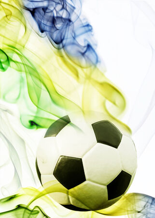 Soccer ball of Brazil 2014 covered in smoke photo