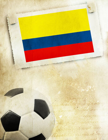 Vintage photo of Colombia flag and soccer ball