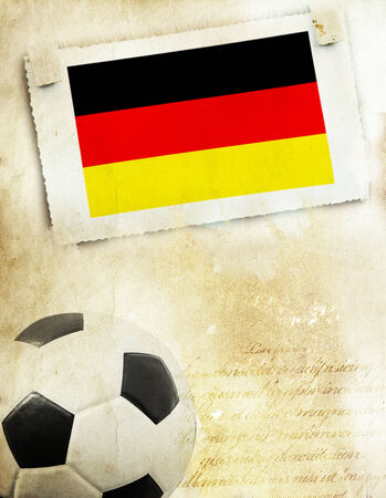 Vintage photo of Germanys flag and soccer ball photo