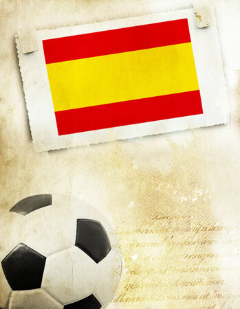 Vintage photo of Spain flag and soccer ball                                    photo