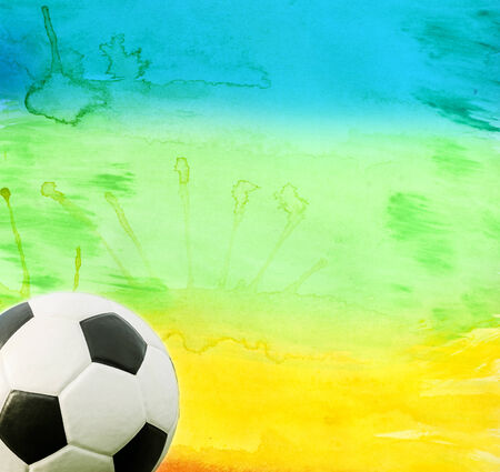 Photo of soccer ball and the colors of the Brazil flag photo