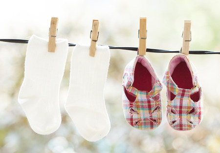 Photo of baby clothes hanging on the clothesline photo