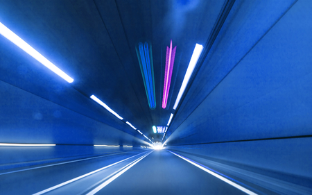 Abstract speed motion in urban highway road tunnel photo
