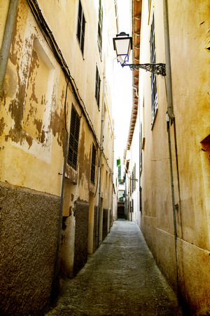 Vintage photo of narrow street in old city of Palma de Mallorca, Spain photo