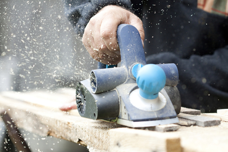 home addition: Carpenter sawing wood