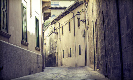 Narrow street in old city of Palma de Mallorca, Spain photo