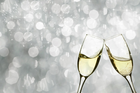 Champangne glasses on sparkling background photo