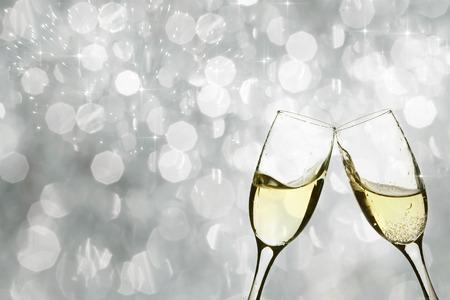Champangne glasses on sparkling background
