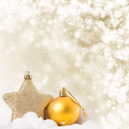 Golden Christmas background with christmas ball and star photo