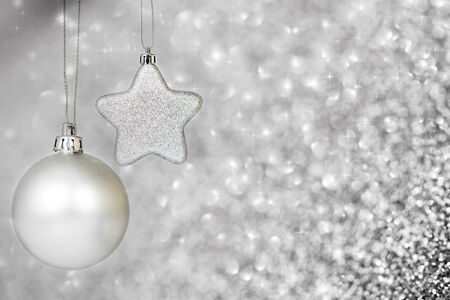 Silver christmas decoration with ball and star on holiday background photo