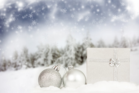 Silver Christmas decorations with star bauble and gifbox photo