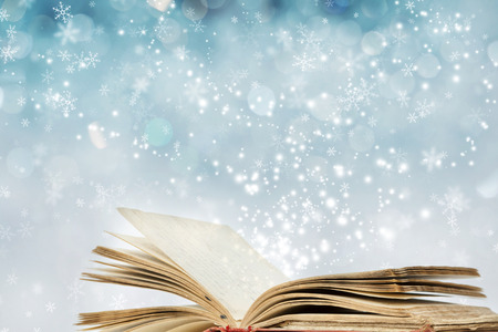 new books: Christmas fairy-tale. Christmas background with magic book