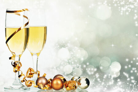 new year eve beads: Glasses with champagne and Christmas decoration on winter background