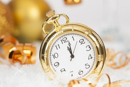 Old golden clock close to midnight and sparkling Christmas decoration - New Year concept photo