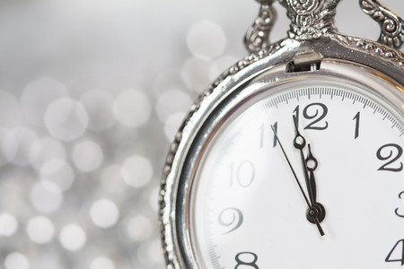 Old silver clock close to midnight and sparkling Christmas decoration - New Year concept photo