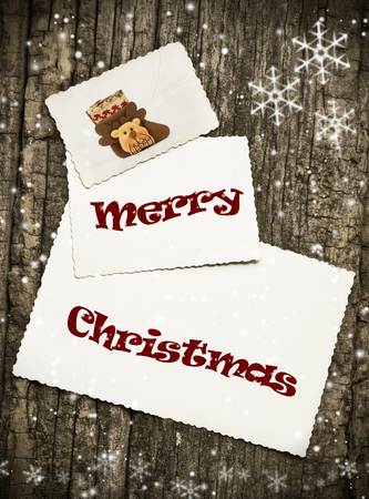 Vintage Christmas greeting card on wooden background photo