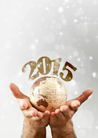 New Year over the globe earth hold by man`s hands photo