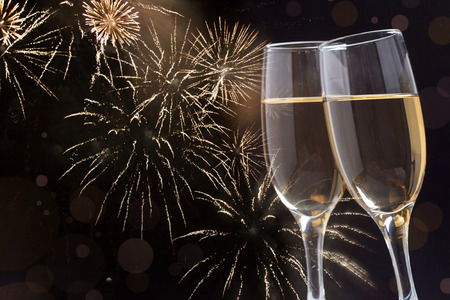 Glasses with champagne against fireworks Banque d'images