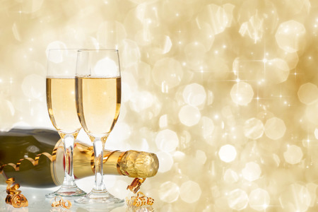 champagne flute: Glasses with champagne and bottle over fireworks and sparkling holiday background Stock Photo