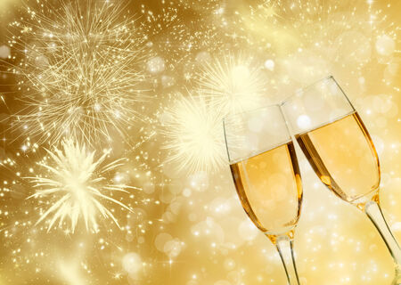 Glasses with champagne against sparkling holiday lights photo