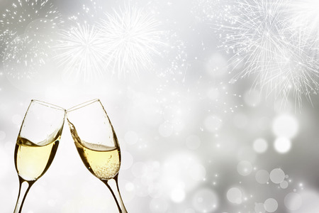 Glasses with champagne against fireworks and holiday lights Archivio Fotografico