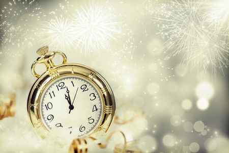 New Year's at midnight - Old clock with fireworks and holiday lights Archivio Fotografico