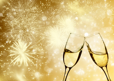 new year eve beads: Glasses with champagne against fireworks and holiday lights Stock Photo